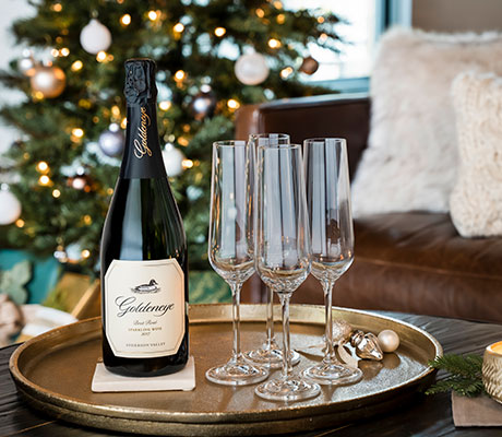 Goldeneye Sparkling wine with for glasses of sparkling in front of a tree