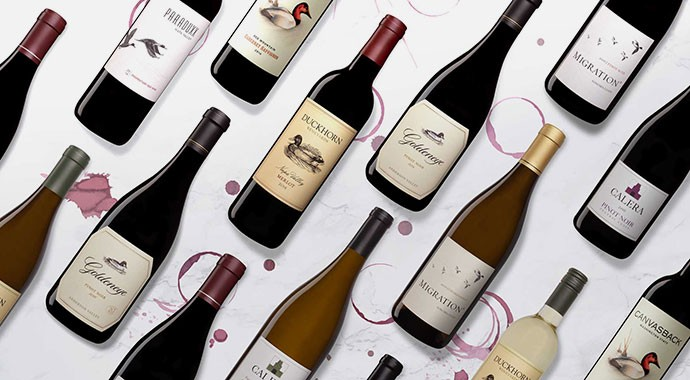 Duckhorn Portfolio wines on a white marble background
