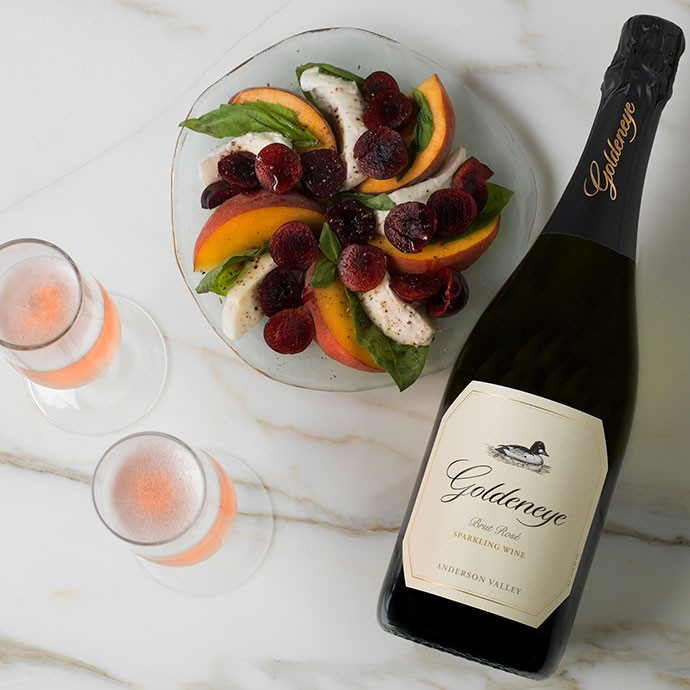 Goldeneye Sparkling Wine paired with a peach and mozzarella salad