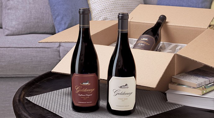 Goldeneye Pinot Noir wines on a coffee table