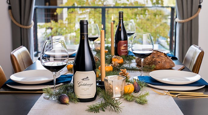 Goldeneye Pinot Noir on the a holiday decorated table